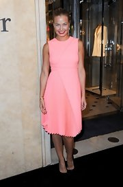 Lara Bingle looked lovely at the Dior store opening in this retro peach shade and asymmetrical pleats.