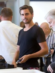 Scott Disick was casual and cool in a black t-shirt while going through security at LAX.