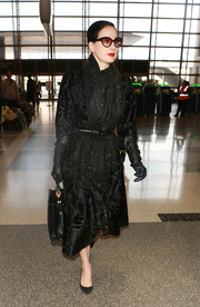 Dita Von Teese styled her chic coat with a color-speckled scarf.