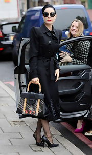 Dita Von Teese stepped out for a little shopping wearing a pair of classic black pumps.