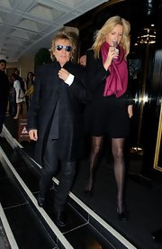 Rod Stewart sported a plaid evening coat while out with with his wife Penny Lancaster.