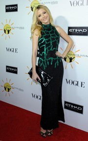 Madison Walls paired a black patent leather clutch with a beaded gown for her Dream for Future Africa Foundation Gala look.