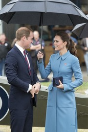 Kate Middleton looked sharp in a blue Alexander McQueen coat while touring the Omaka Aviation Heritage Centre.