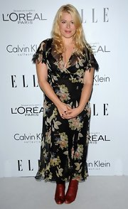 Amanda de Cadenet wore a pair of leather ankle-boots to match her floral dress.