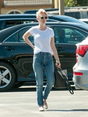 January Jones accessorized with a stylish black leather tote by 3.1 Phillip Lim.