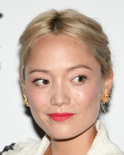Pom Klementieff attended the 'Extraordinary: Stan Lee' event wearing her hair in a slightly messy, center-parted updo.