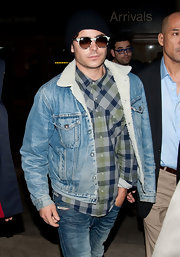 Zac Efron looked ruggedly stylish in this shearling lined jean jacket for his flight to LAX.