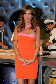 Elisabetta showed off her hot curls in a mandarin cocktail dress. Hot pink trim completed her look.