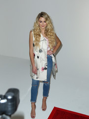 Chloe Lukasiak contrasted her dainty coat with edgy jeans.