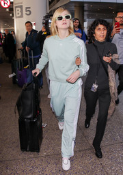 Elle Fanning kept it super laid-back all the way down to her white slip-ons.