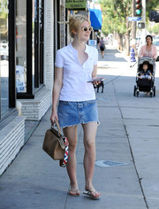 Elle Fanning teamed her top with a frayed denim mini skirt.