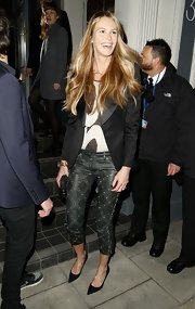 A classic black blazer dressed up Elle MacPherson's evening look.