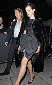 Emma Watson made a grand exit from the Elle Style Awards in an ultra-elegant black velvet coat.