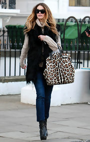 Elle MacPherson looked stylish as ever running errands with an au courant leopard print tote. A furry oversize vest completes the exotic look.