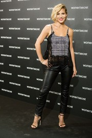 Elsa Pataky was equal parts sultry and edgy in a gray and black lace-trimmed cami teamed with leather skinnies at the 'Dark Seduction' launch.