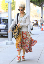 Elsa Pataky dressed down in an off-white V-neck sweater for a day of errands.