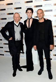 At Elton John's Winter Ball, model Erin O'Connor wore a black floor-length long-sleeve cut-out dress with a plunging neckline and train.