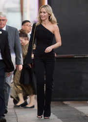 Emily Blunt showed off her svelte figure in a fitted one-shoulder jumpsuit by David Koma while headed to 'Kimmel.'