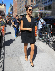 Emily Ratajkowski was spotted out in New York City wearing an oversized black Vera Wang vest and not much else.