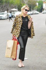 Emma Roberts looked groovy in a leopard-print pea coat by Coach while shopping in LA.