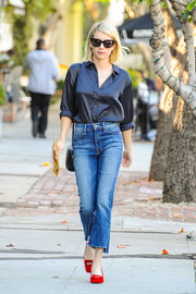Emma Roberts paired her shirt with cropped, step-hem jeans by Mother.