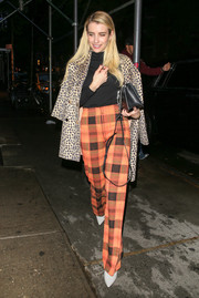 Emma Roberts looked funky in a pair of orange plaid pants while out in New York City.