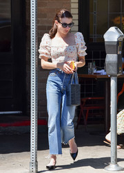 Emma Roberts teamed her top with high-waisted, frayed-hem jeans by Re/Done.