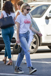 Emma Roberts continued the relaxed vibe with a pair of ripped boyfriend jeans by Frame.