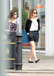 Emma Watson kept it cool and casual with this black cardigan, which she paired over a white top.