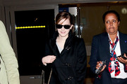Emma Watson is all smiles as she arrives at LAX (Los Angeles International Airport) after attending Paris Fashion Week.