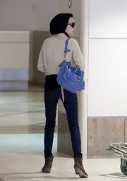 Emma Roberts brightened her travel look with the much coveted PS1 bag in lavender.