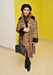 Noomi Rapace went for Old Hollywood glamour in a leopard-print fur coat at the English National Ballet's 'Nutcracker' pre-show reception.