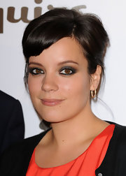 Lily Allen amped up her look with smoldering shadow that was rimmed around her upper and lower lids.
