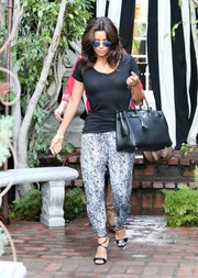 Eva Longoria kept it relaxed in Michael Lauren monochrome print pants teamed with a black tee while out in Beverly Hills.