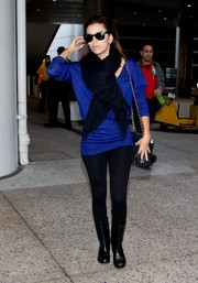Black mid-calf boots toughened up Eva Longoria's travel outfit.