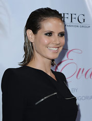 Heidi Klum sported a look that came right off the Spring 2010 runways. The slicked look is still out for debate, but some would argue Heidi can pull anything off.