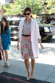 Eva Mendes' white wool coat and floral dress were a flawless pairing.