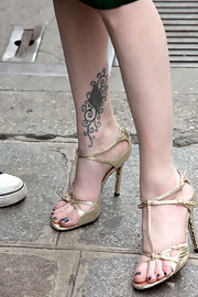 Evan Rachel Wood adds sex appeal with these gold metallic strappy sandals.