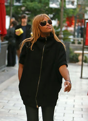 Eve looked futuristic in her floating lens sunglasses and zippered top while shopping at the Grove.