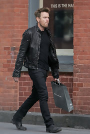 Ewan rocked a bad boy ensemble complete with worn leather boots.
