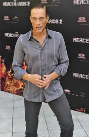 Jean-Claude Van Damme looked trim in his striped gray button-down during the 'Expendables' photocall.