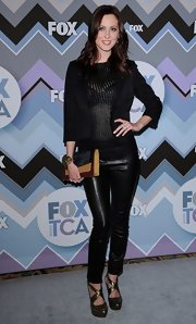 8186280b5d2b3 Eva wore a black blazer over her sheer blouse for this edgy look at the Fox