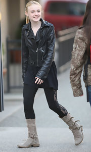 Dakota Fanning accessorized in taupe suede flat boots complete with buckled detailing.