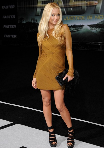 Charlotte Ross made an impact in black platform strappy sandals. The heels gave a bold finish to her mustard long sleeved dress.