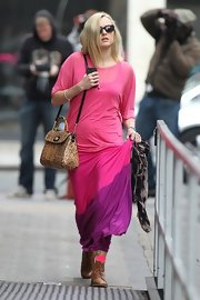 Fearne Cotton paired her boldly colored ensemble with neon pink anklets and tan lace-up boots.