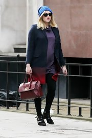 "Fearne was up on the season's oxblood trend with this gorgeous cranberry ""Del Rey"" bag."