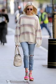Fearne Cotton walked to work in London wearing a pair of ultra-bright pink strappy wedge sandals.