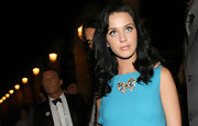 This multi-colored, bow, pendant necklace adds a burst of glitz to Katy's teal ensemble.