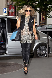 Fergie wore futuristic leather moto pants with her leopard print tunic while out in Paris.
