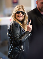 Fergie loves her statement jewelry. She paired her edgy leather jacket with a silver and gemstone encrusted full finger ring.
